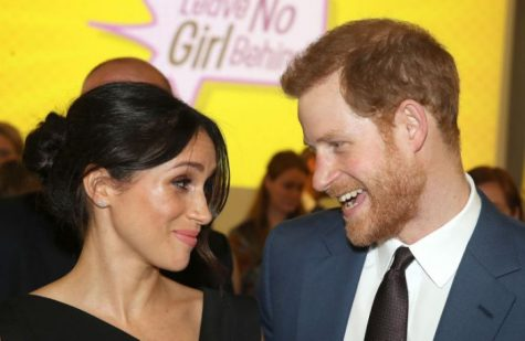 LONDON, ENGLAND - APRIL 19:  Meghan Markle and Prince Harry attend the Women